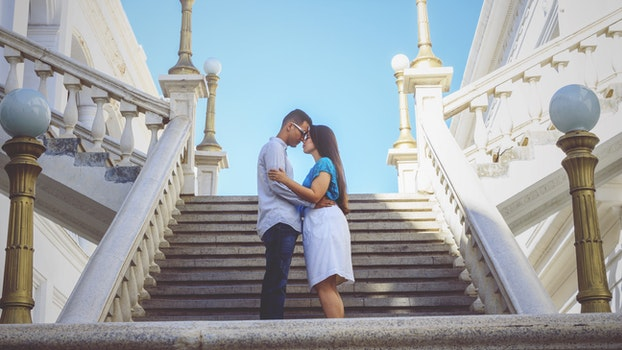 Couple Standing By The Stairs