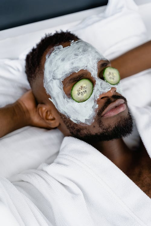 Man in Clay Mask and Cucumber Eye Mask