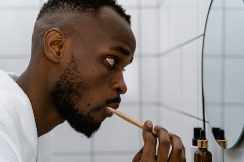Close-up Photo of Man brushing his Teeth
