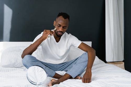Man using Facial Roller on his Face
