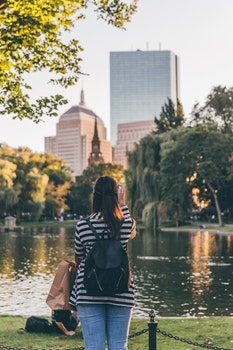 Photo of Woman Standing Near Body of Water