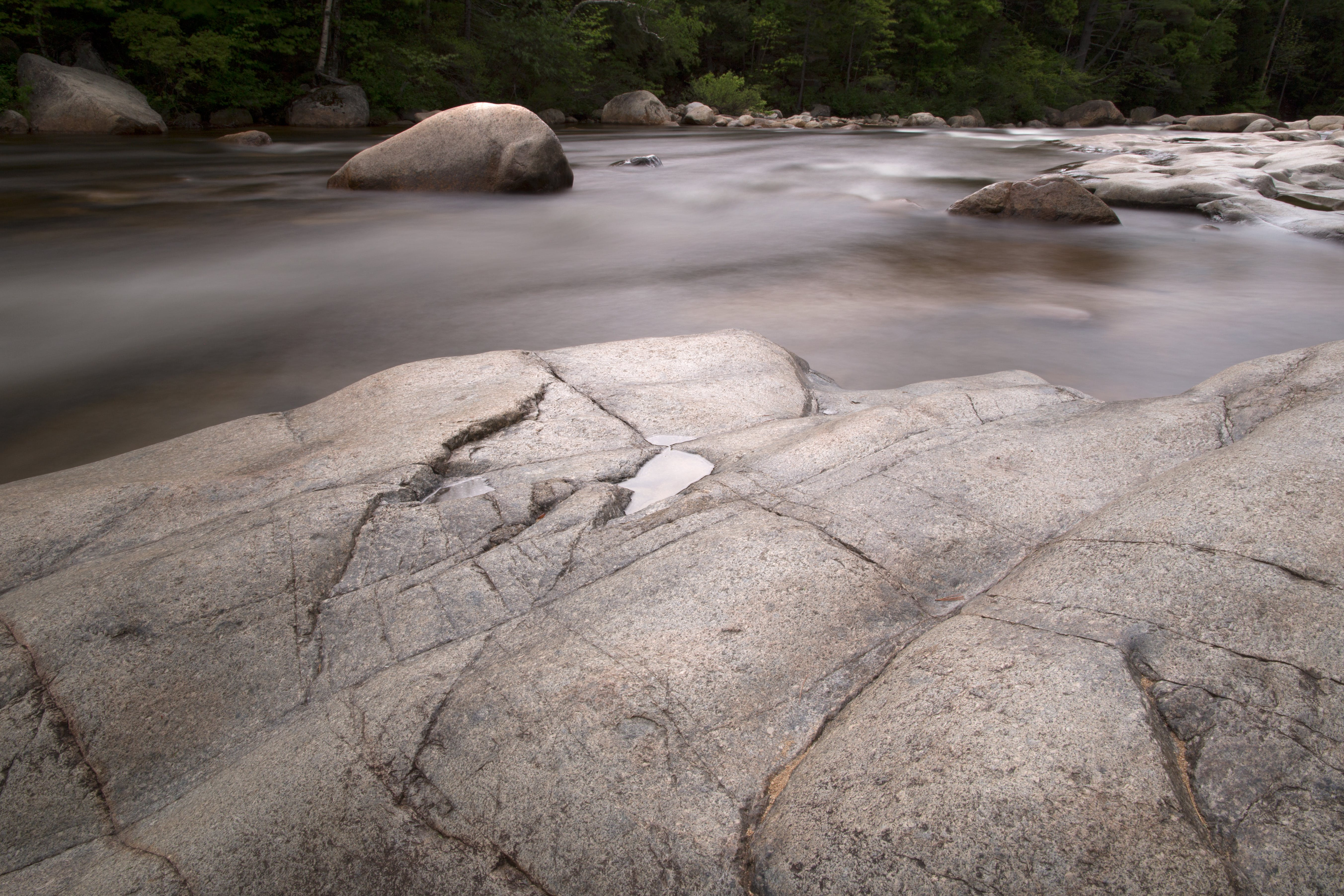 Photography of Rock Formation on Body of Water