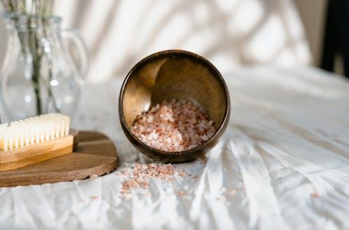 Brown Wooden Round Bowl on White Textile