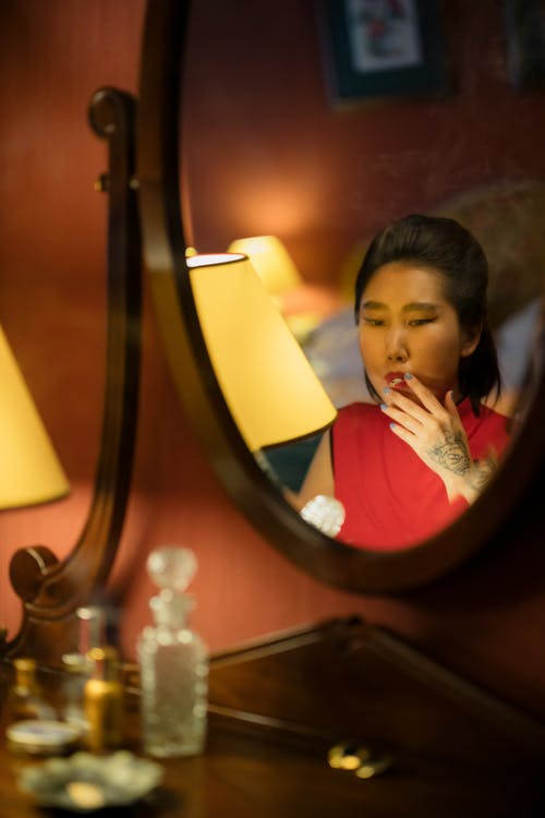 Woman Smoking in Front of the Mirror