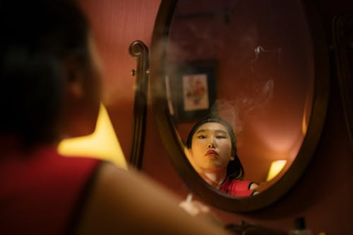 Woman in Front of the Mirror Smoking