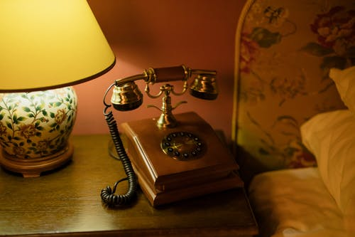 Vintage Telephone Beside the Bed