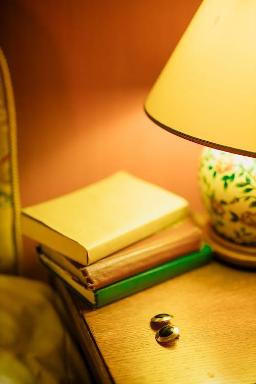 Books ang Earrings on Bedside Table
