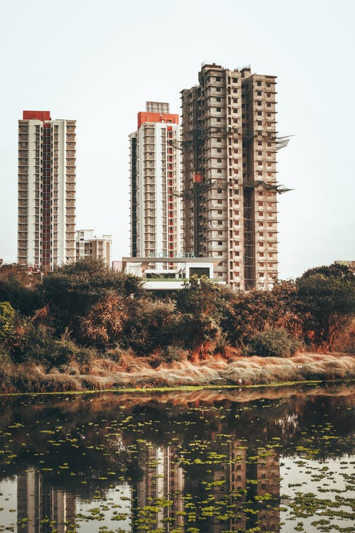 Tall residential buildings on lakeside in modern city