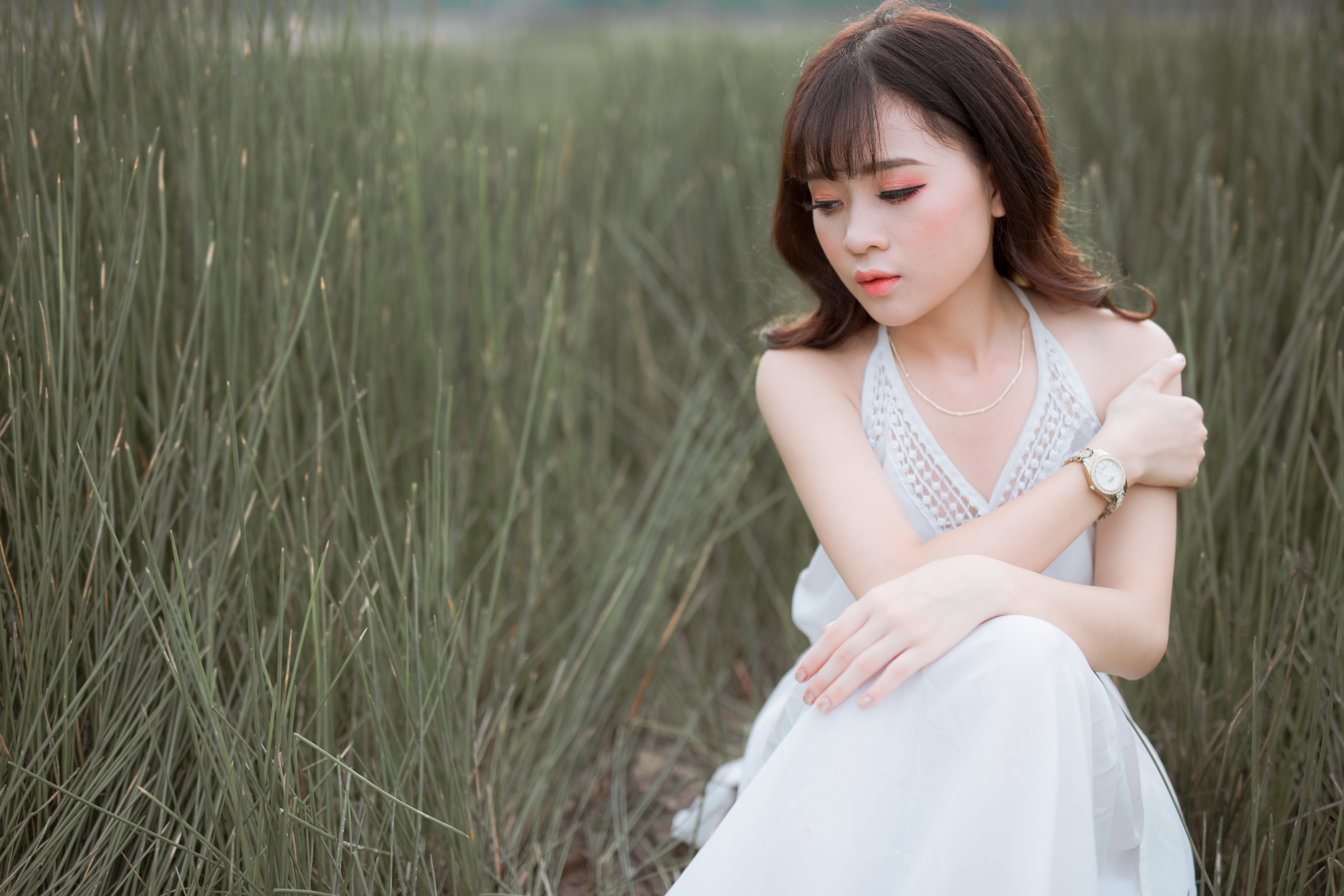 Woman Wearing White Halter Dress Surrounded By Grass