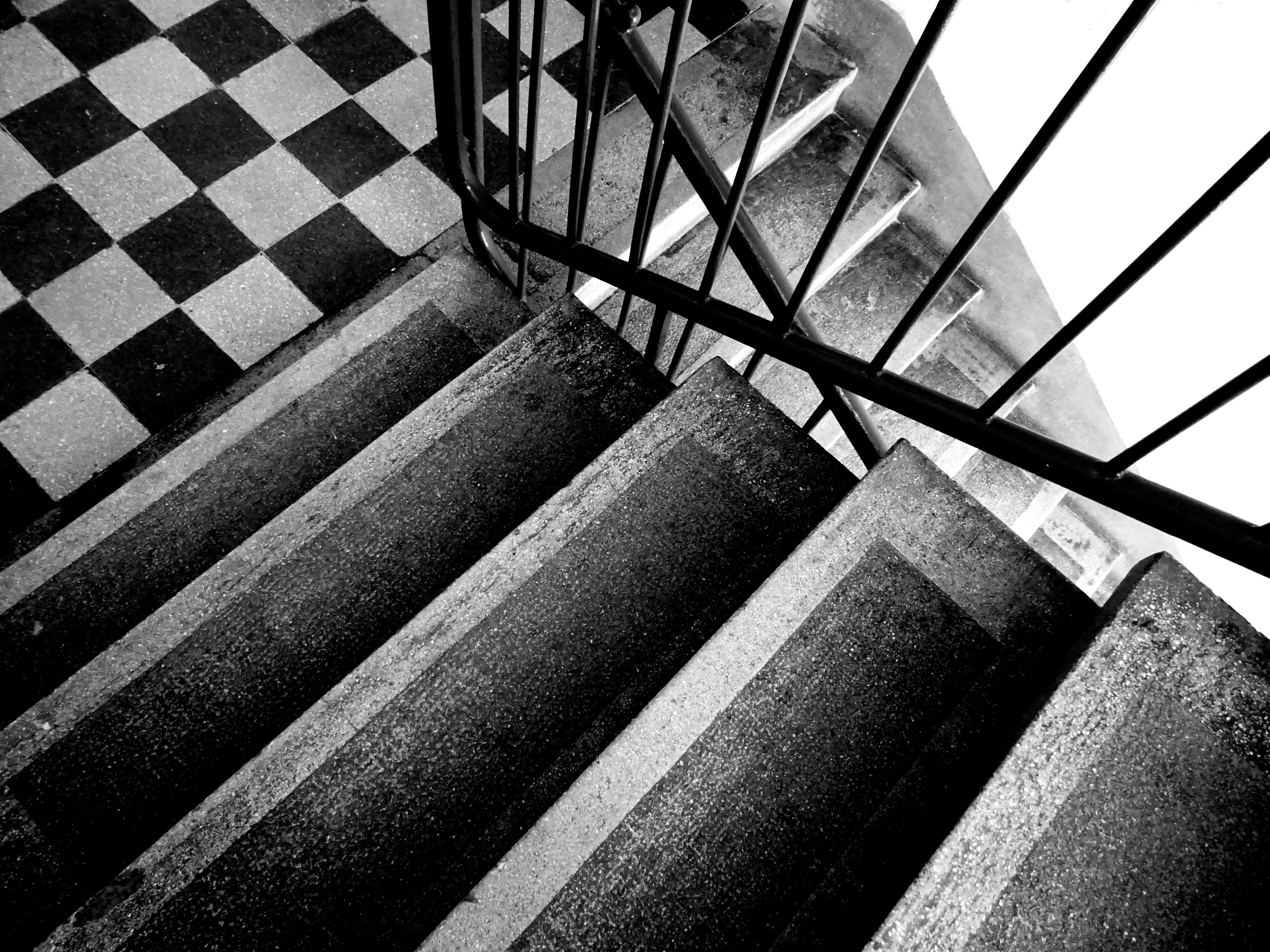 Grey Scale Photo of Stairs
