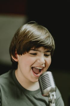 boy singing on the microphone