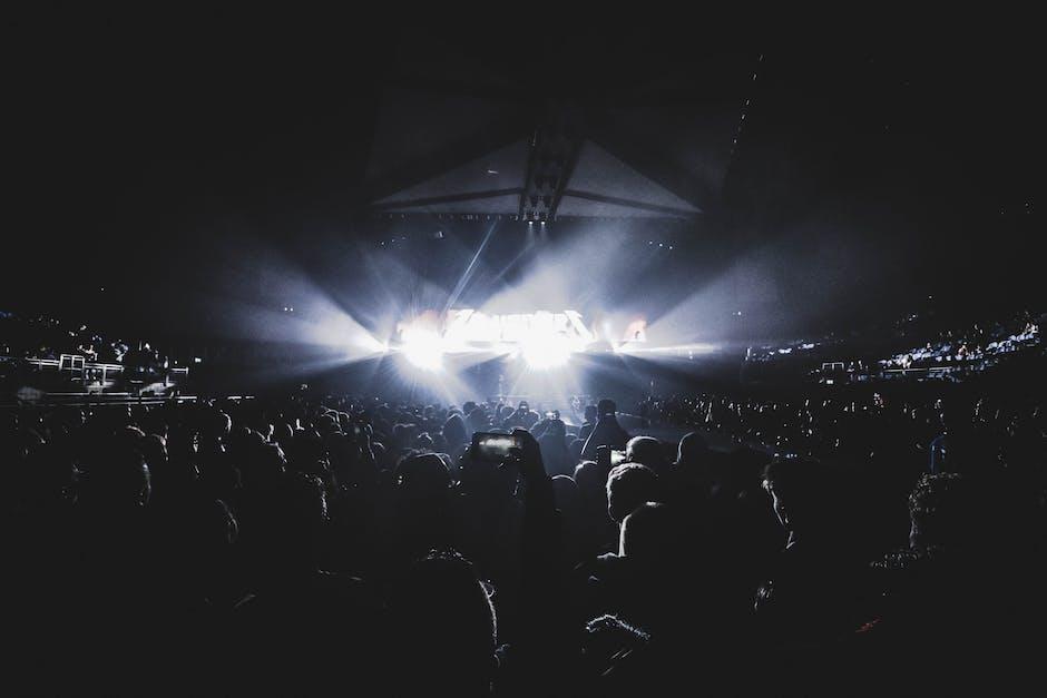 Crowd watching show inside the dark stadium