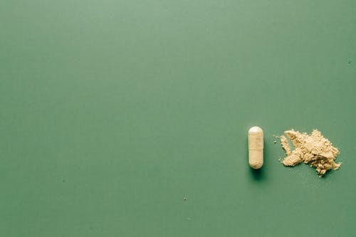 Medication Pill on Green Background