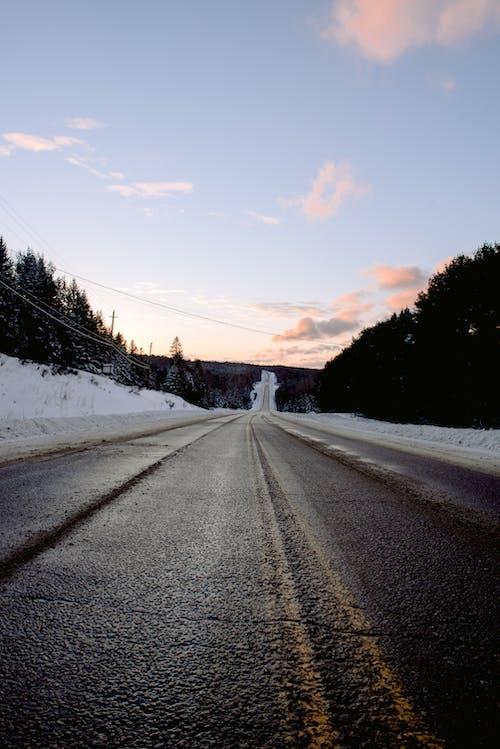 Empty asphalt road on winter day