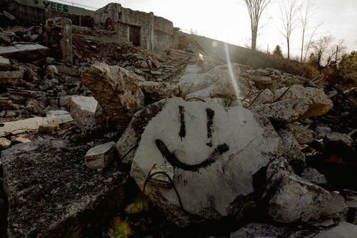 Smiley face on stone in destroyed area