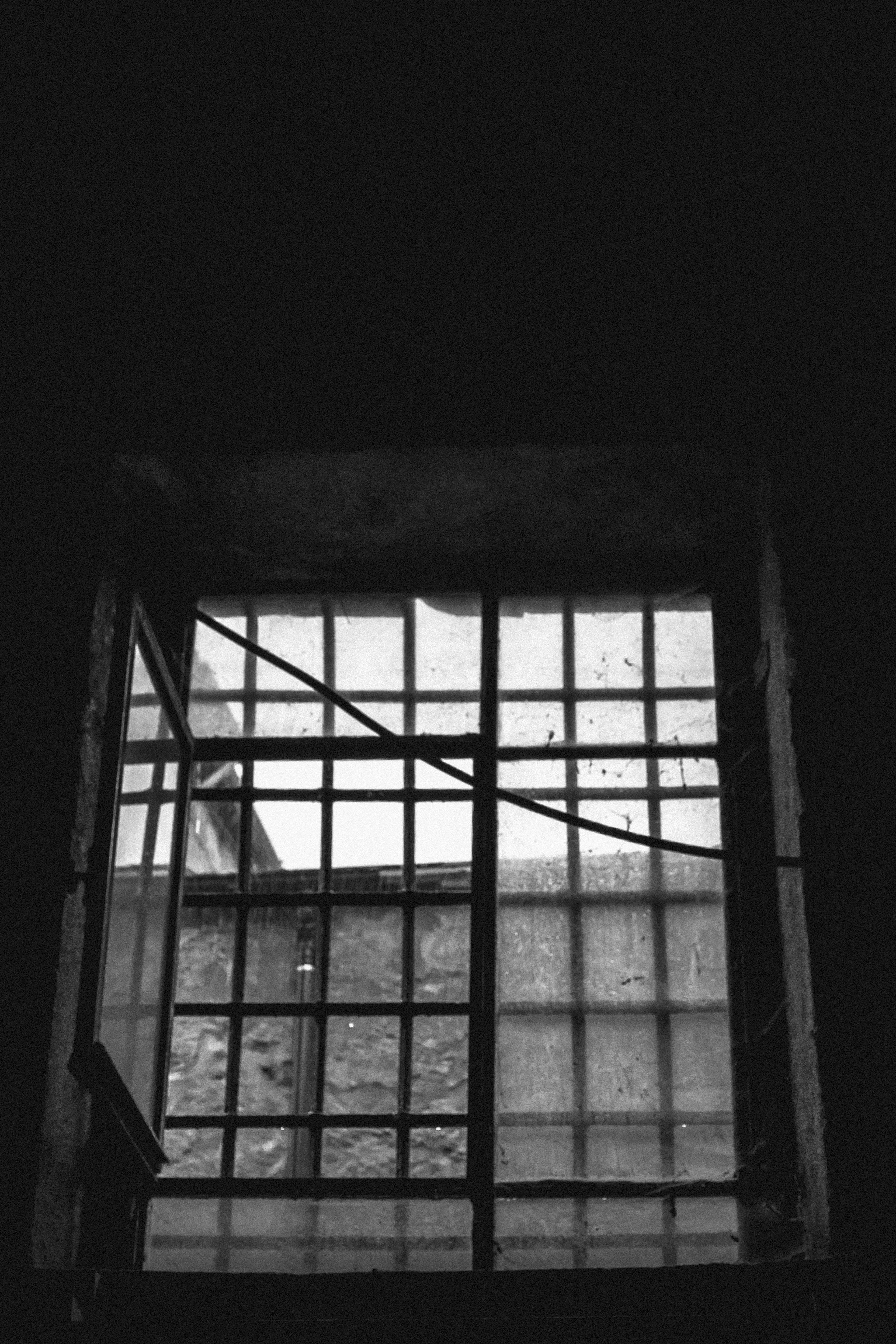 Free stock photo of warehouse, window, bars, looking out