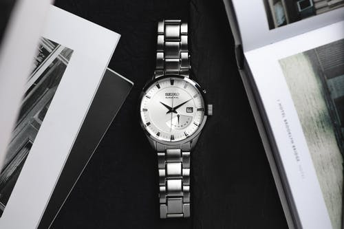 Grayscale Photo of a Silver Wristwatch