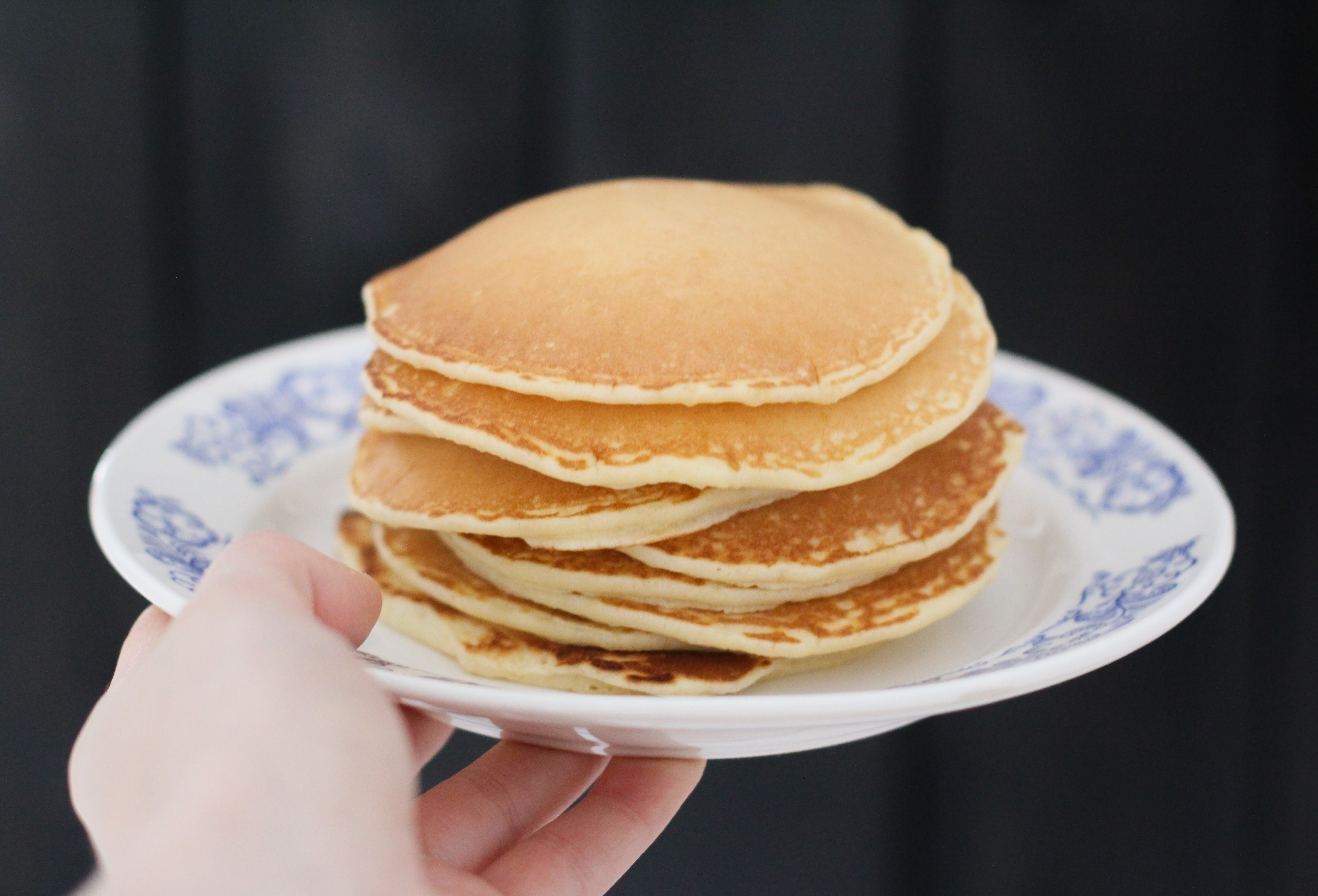 Person Holding Plate With Pancakes