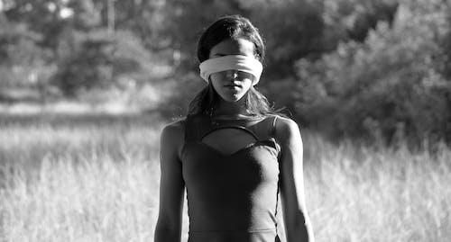 Woman in Black Tank Top Wearing White Headband