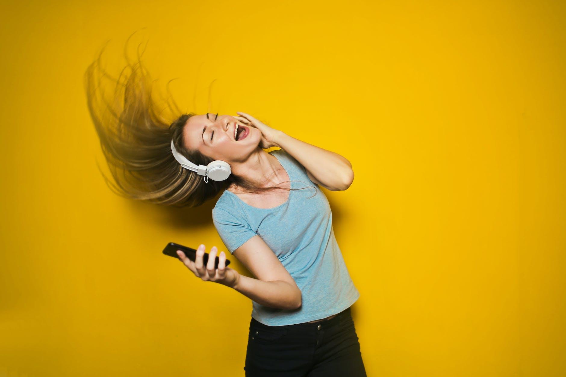 Girl singing along to music