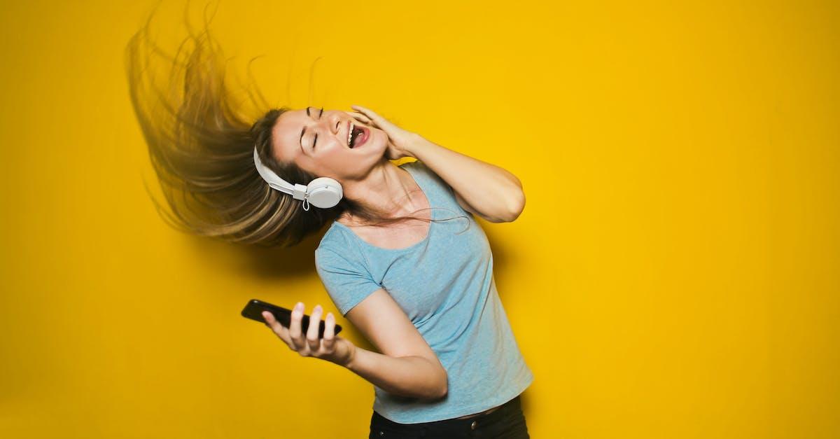 Photography of Woman Listening to u003cbu003eMusicu003c/bu003e · Free Stock Photo