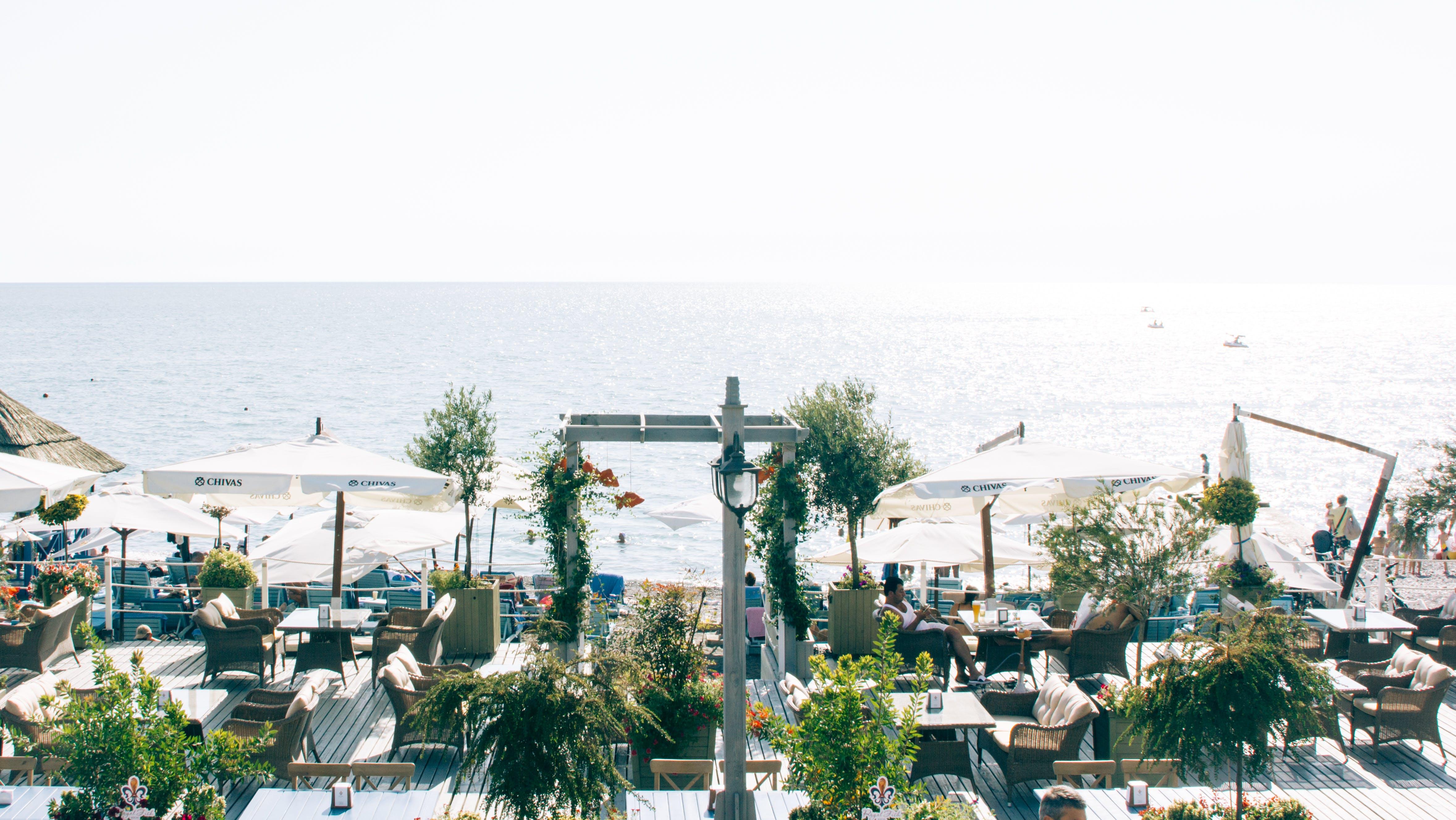 White Patio Table Set Near Ocean