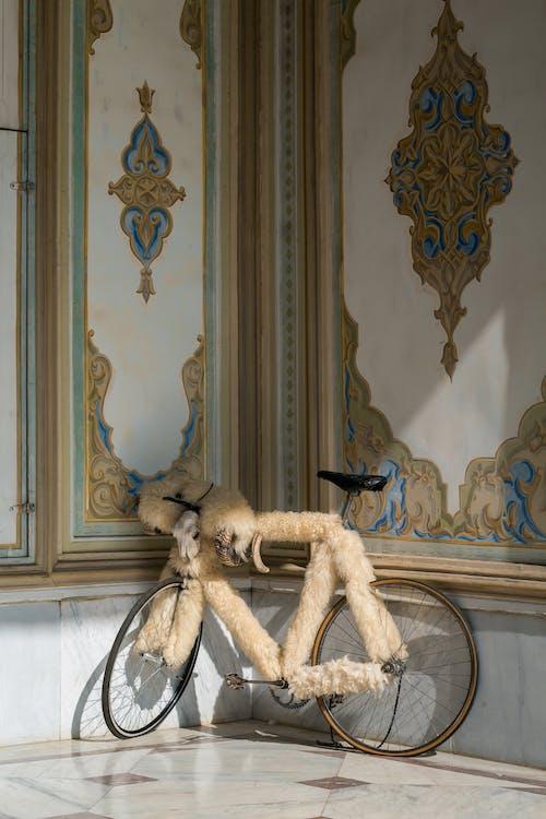 Brown Plush Toy on White Bicycle