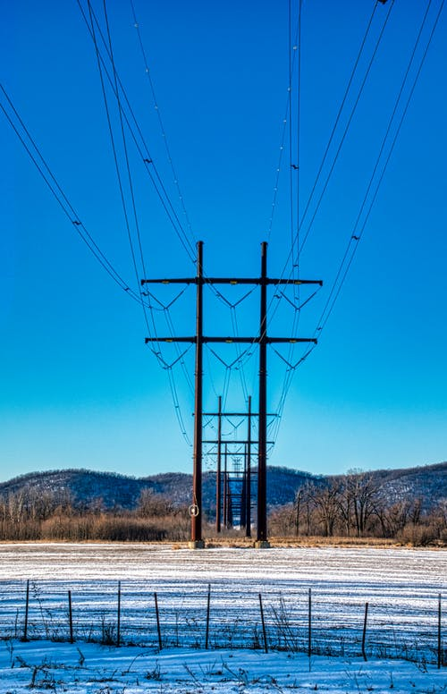 Black Electric Post Under Blue Sky