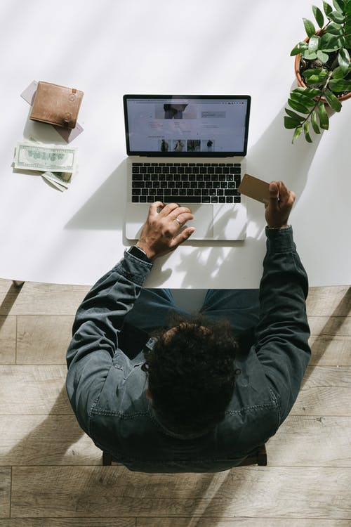 Man in Black Jacket Using Macbook Pro