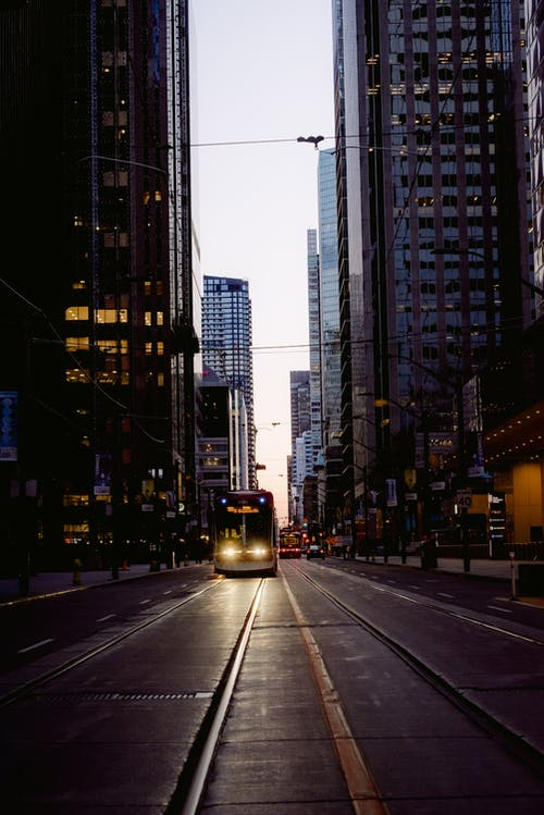 Tram driving in evening city