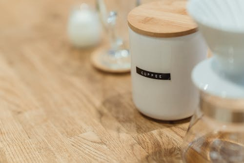 White Ceramic Cup With Coffee on Wooden Table