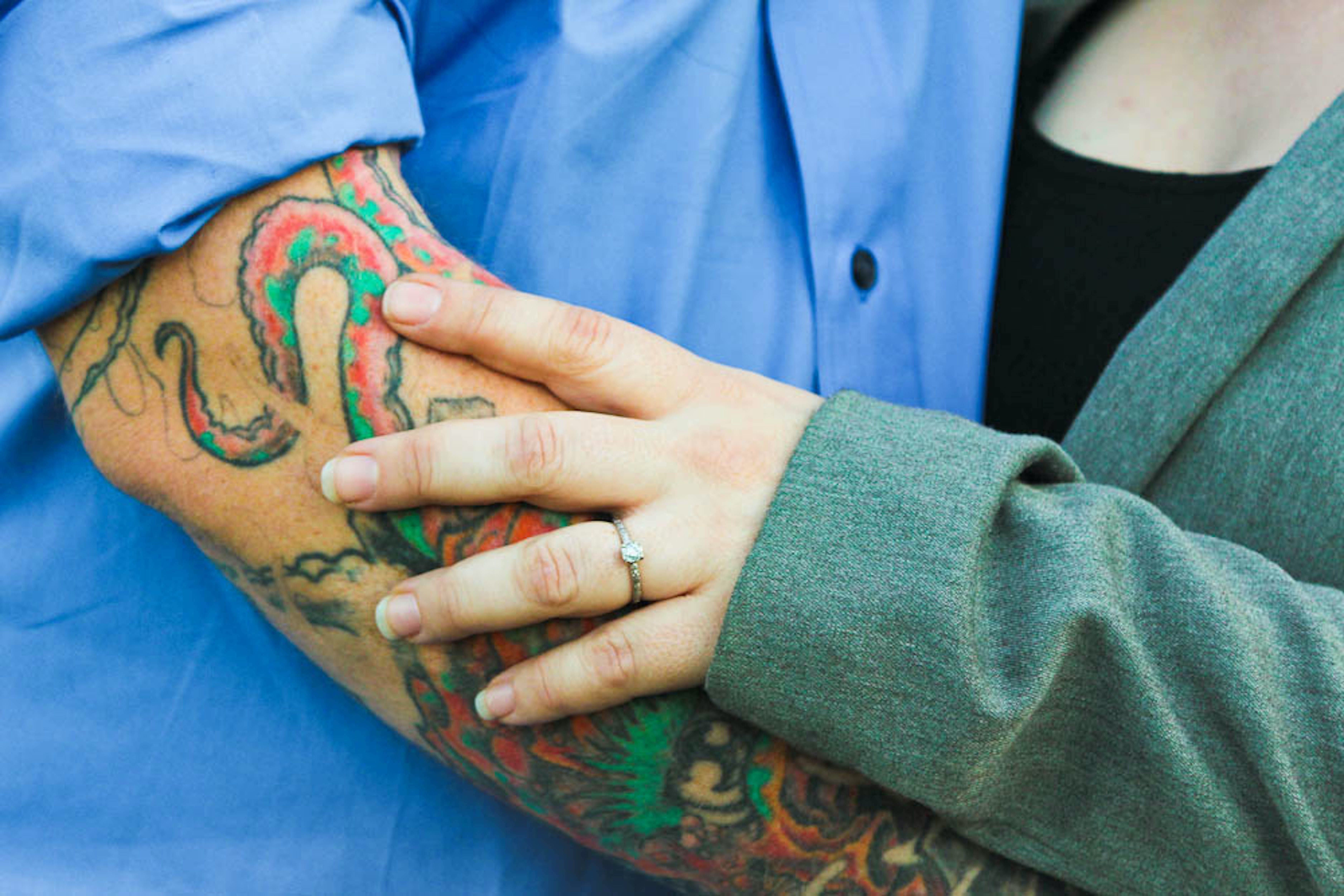 Man With Tattoo With a Woman in Green Top