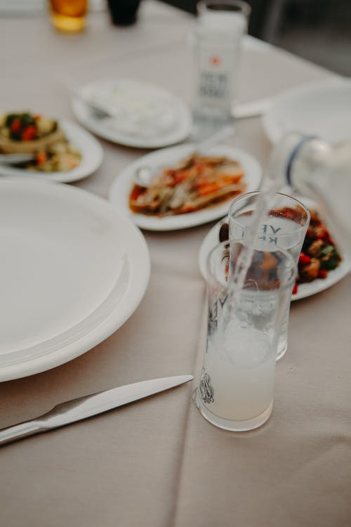 Beverages on table with dishes