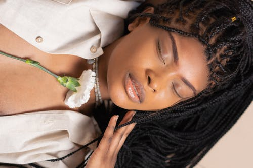 Woman Lying Down with Eyes Closed