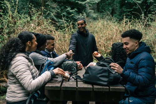 Friends Sharing Snacks to Each Other