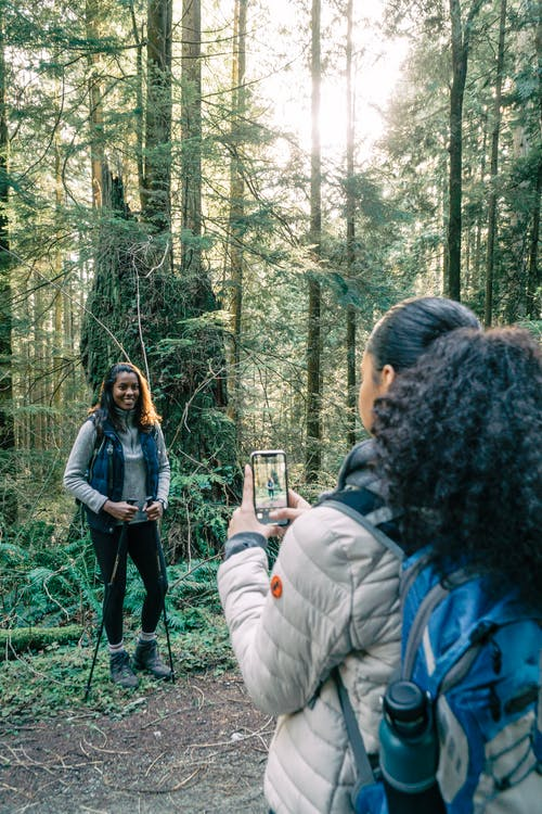 Woman in Black Jacket Standing in Forest