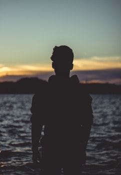 Silhouette Photo of Person Near Body of Water
