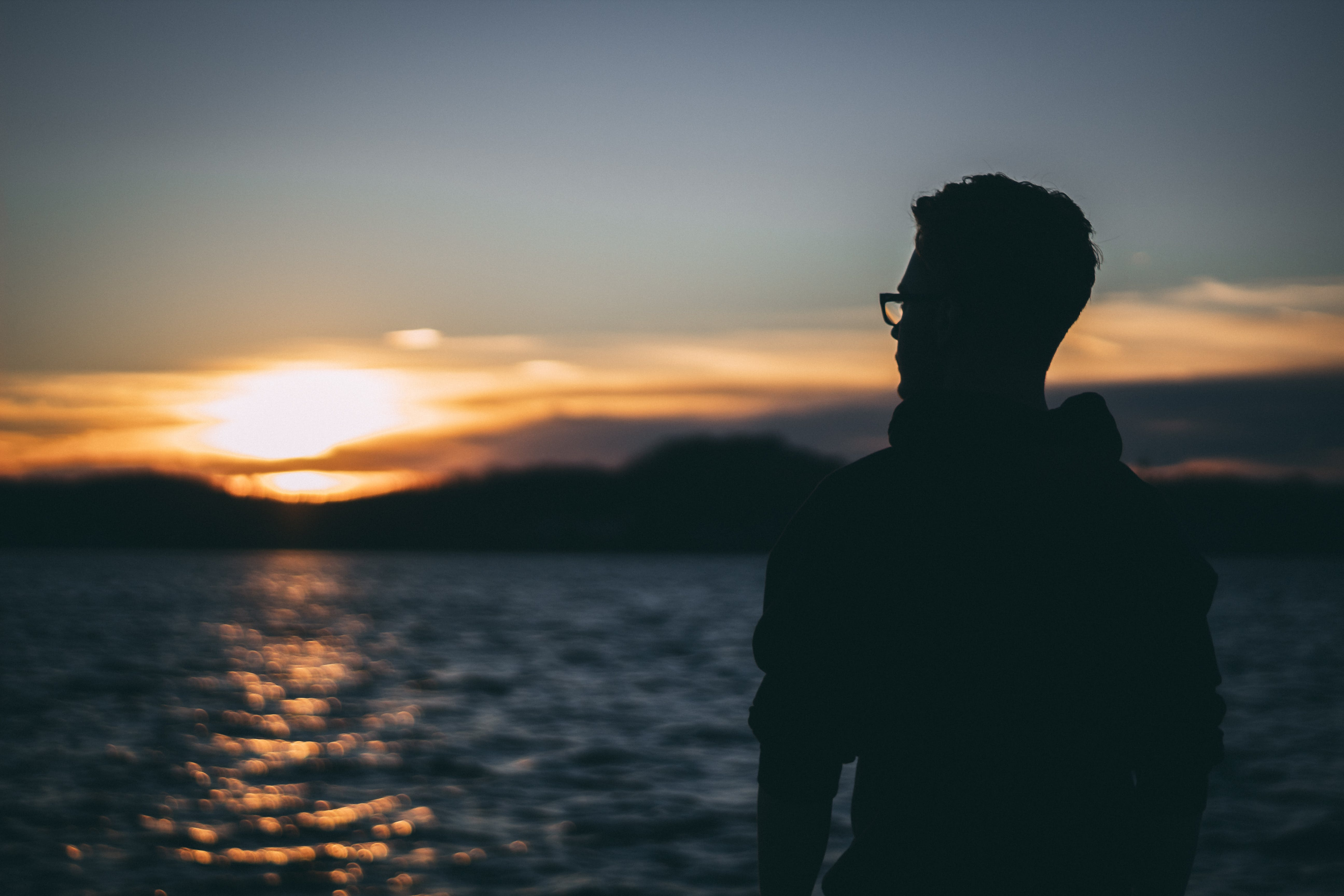 Silhouette of Man during Sunrise