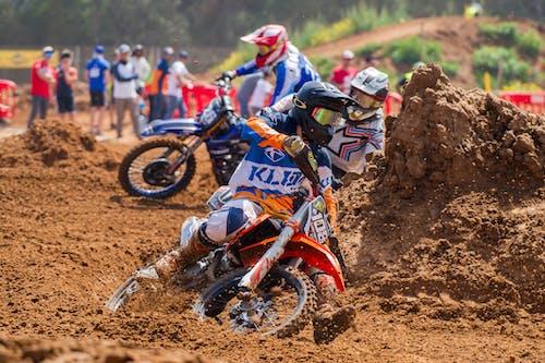 Men Riding In Motocross Dirt Bikes Racing on Track
