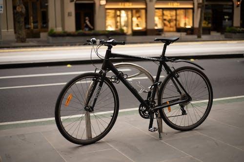 Black Road Bike on Road