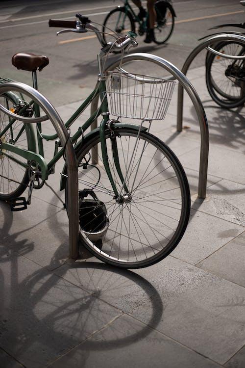 Green City Bike on Gray Concrete Floor