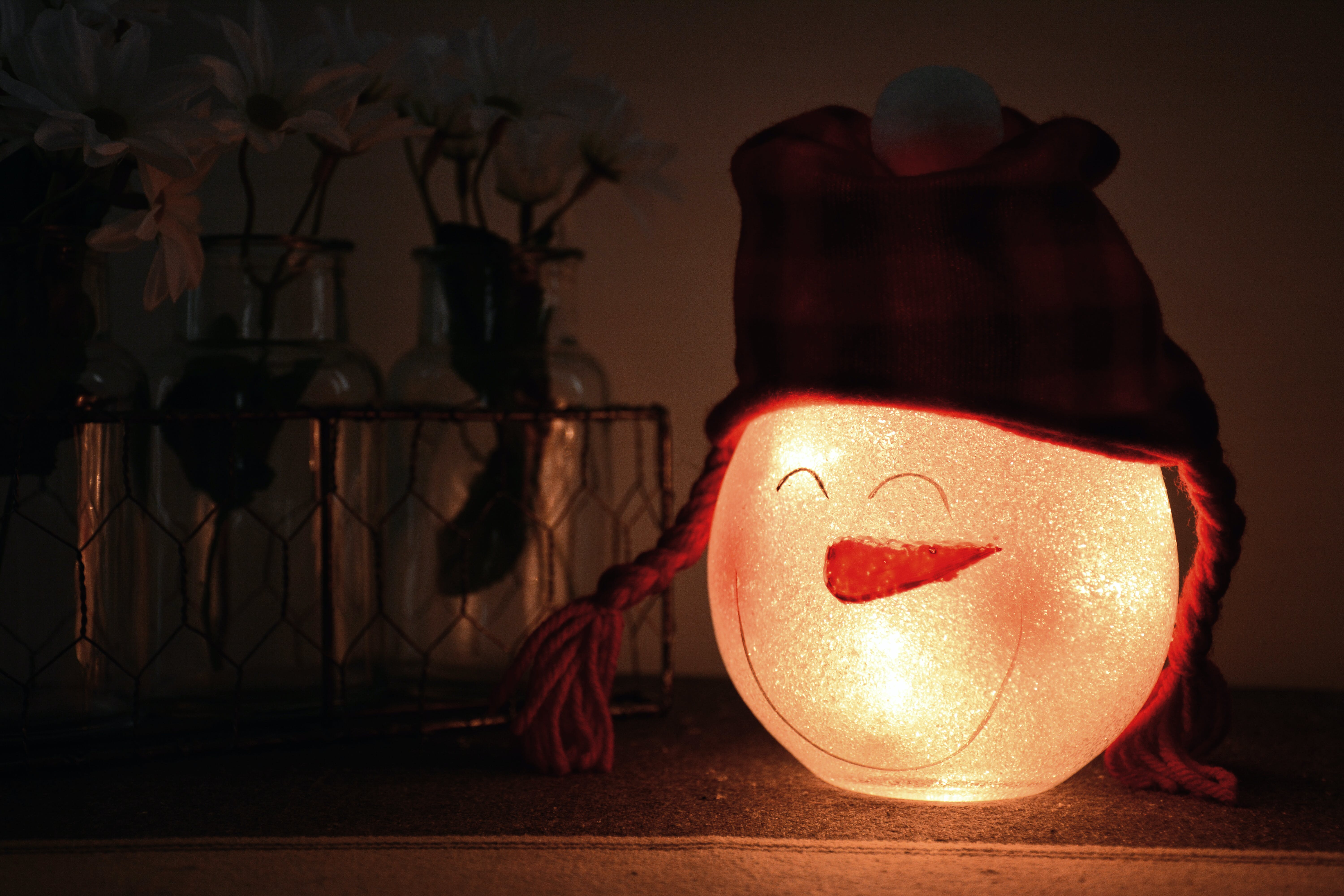 Shallow Focus Photography of White Led Snowman Lamp