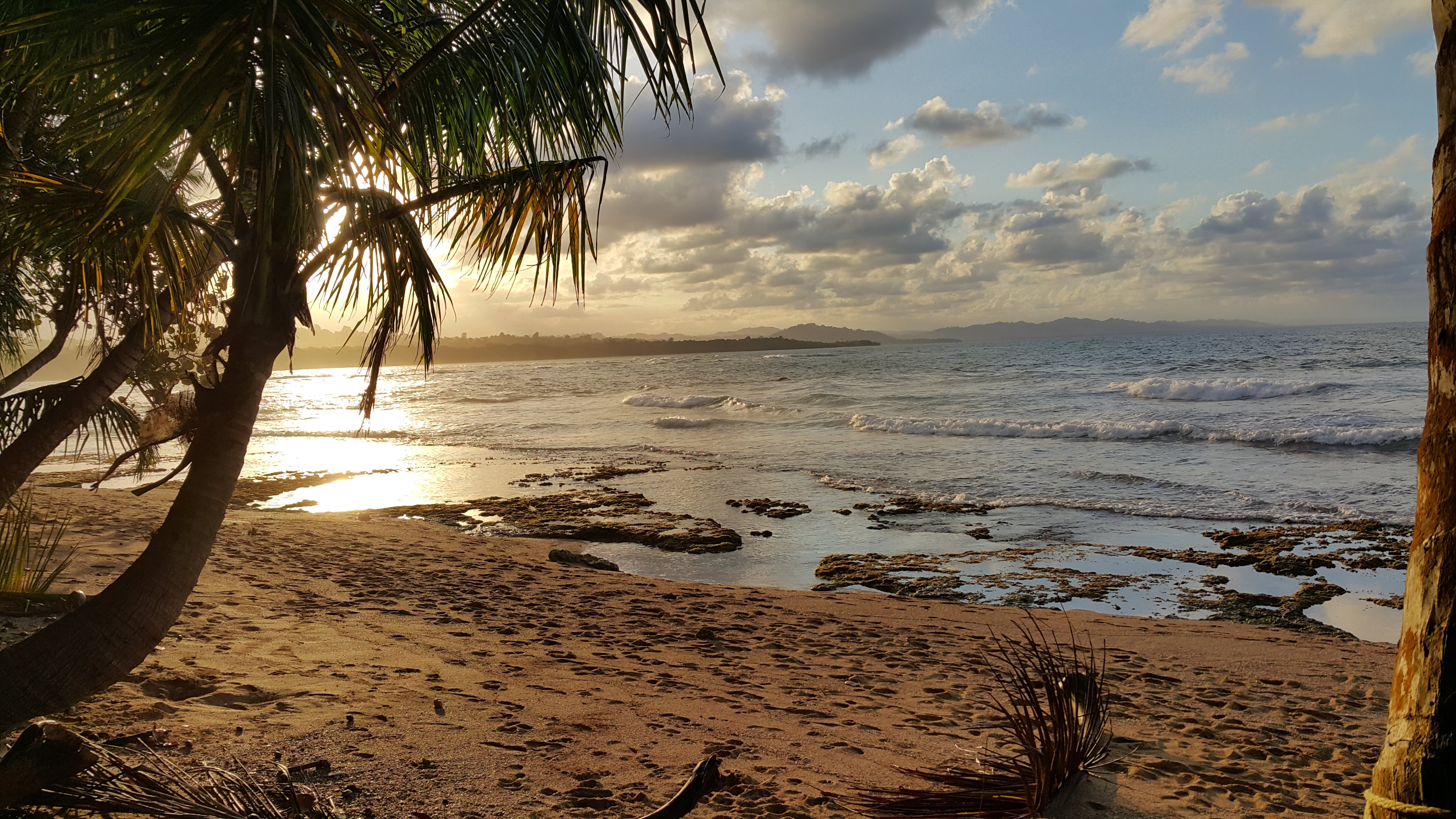 Landscape Photo of Beach Under Partly Cloudy Skies