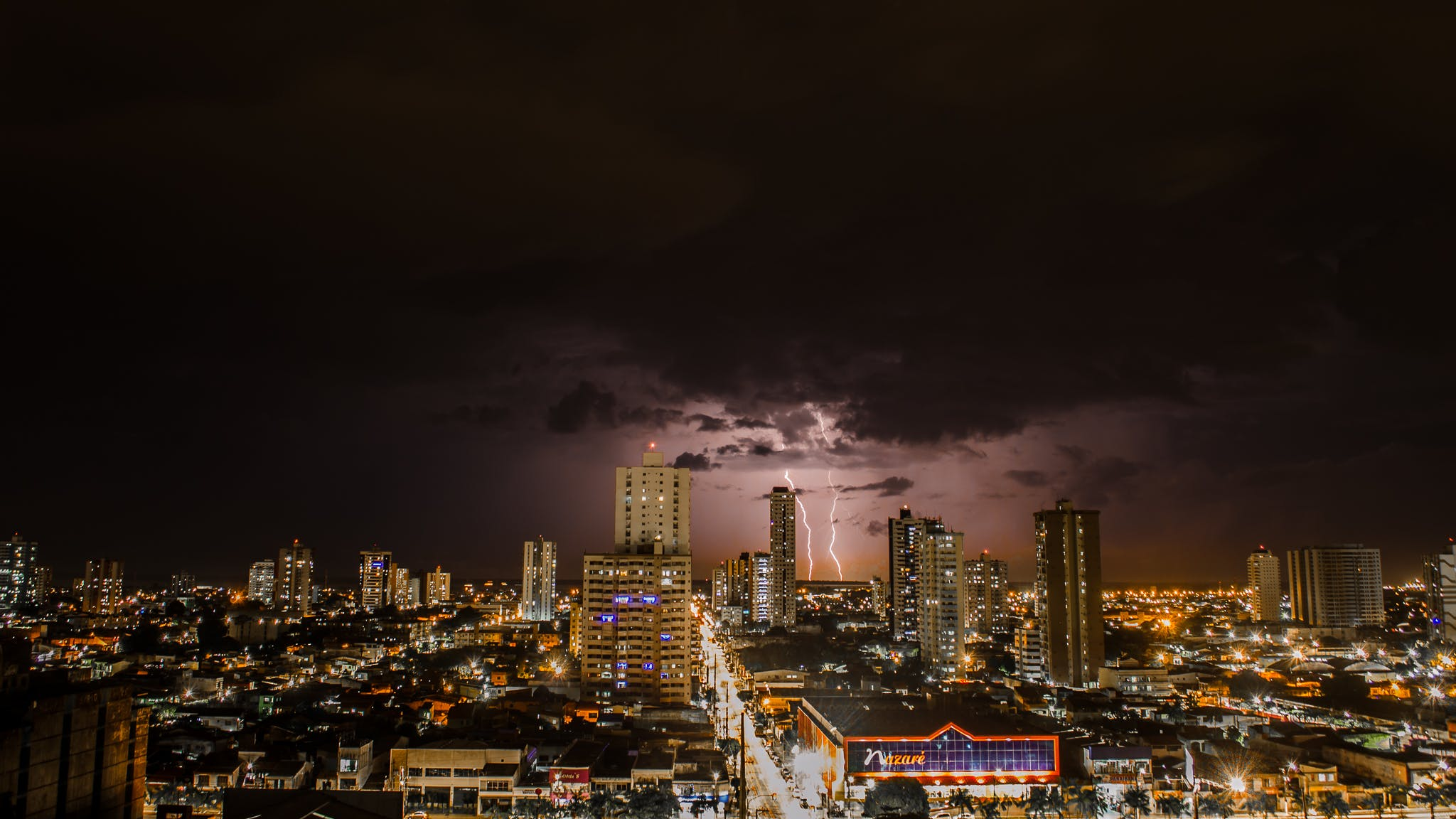 Thunderstorms Above City during Night Time