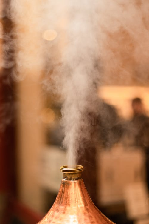 Smoke Coming from a White Smoke from a Brown Wooden Bottle