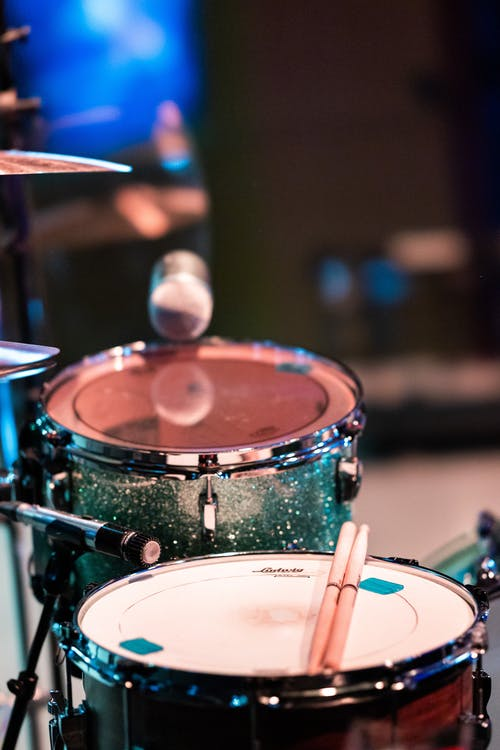 Drum kit and microphone on stage in night