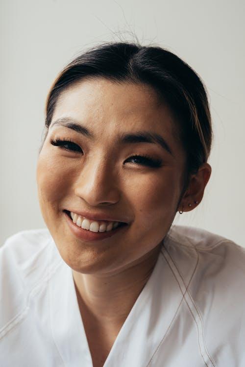 Smiling Asian woman looking at camera