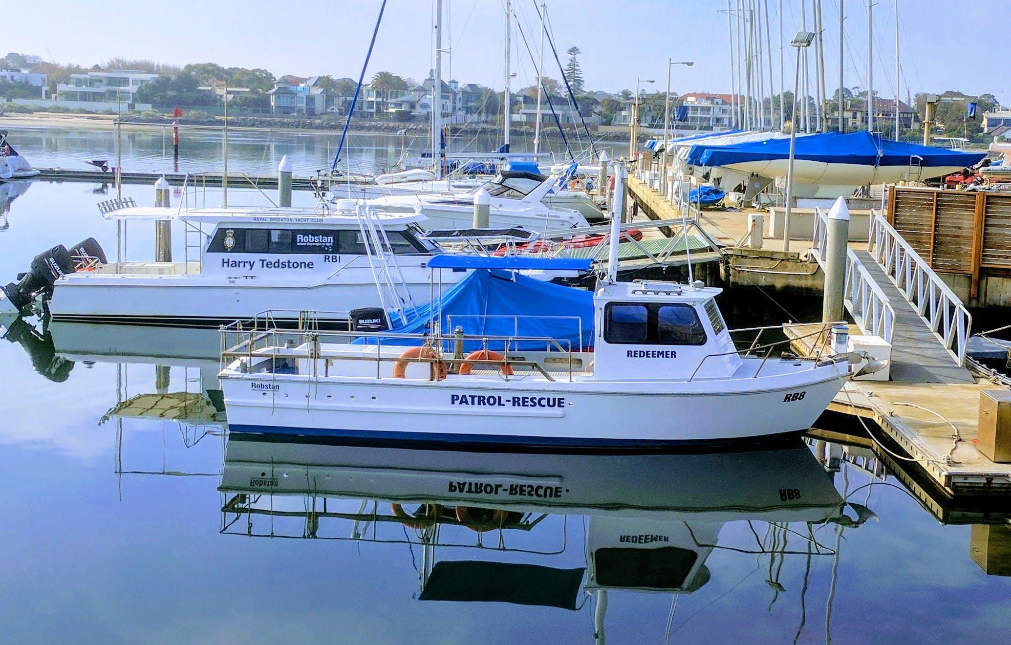 White Patrol-rescue Boat Near Brown Wooden Sea Dock