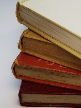 Four Assorted-color Hardbound Books