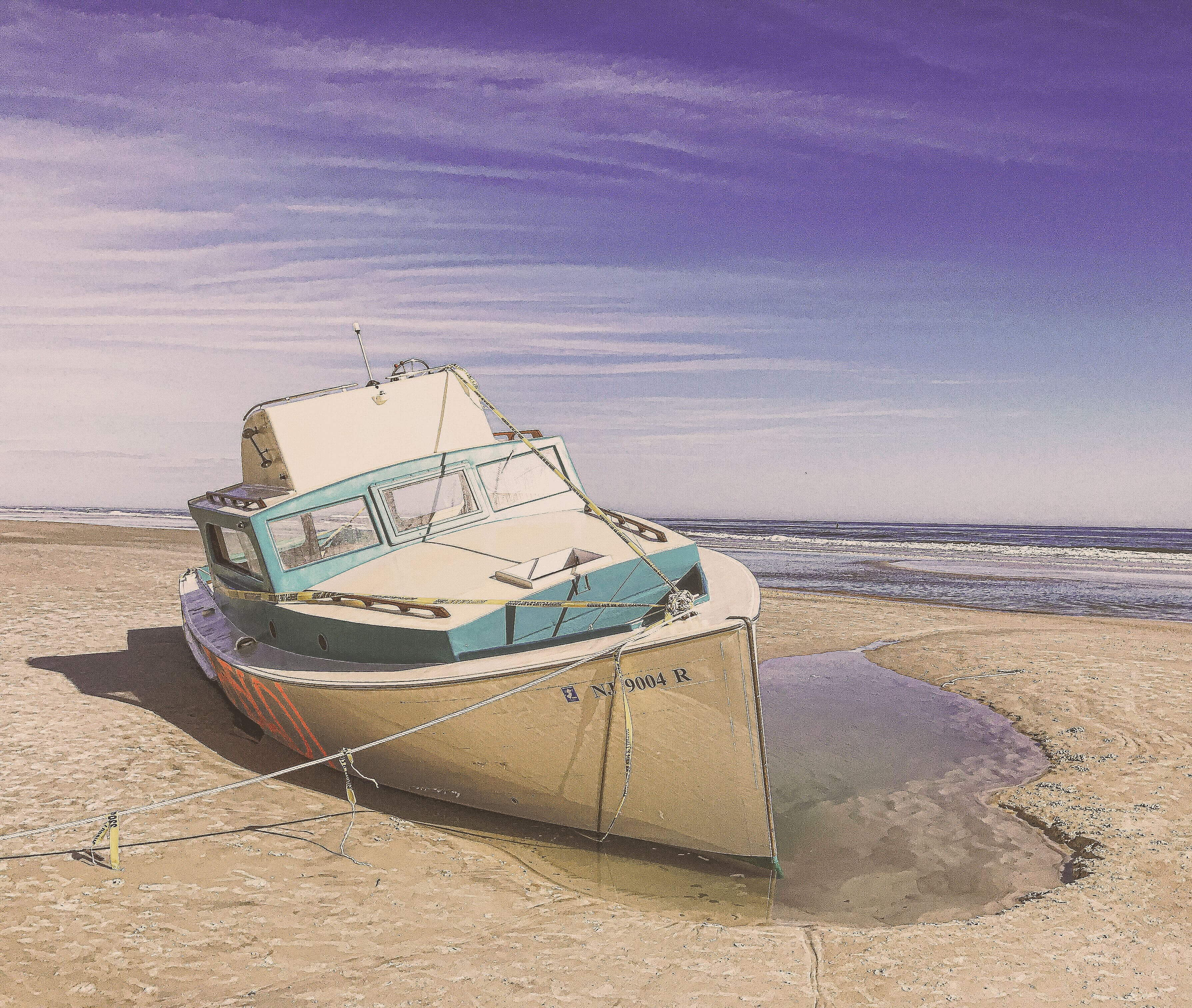 White and Teal Speedboat on Land